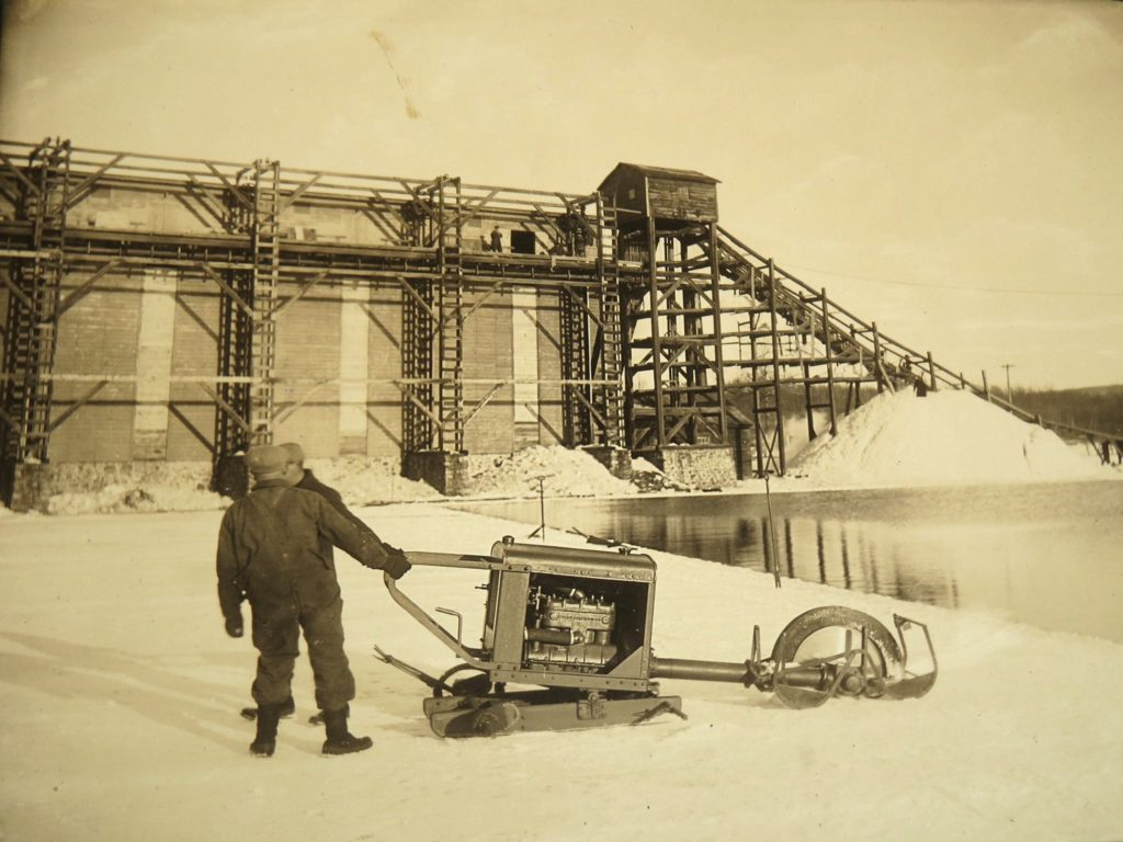 View of gasoline-powered ice saw in front of the Greenwood ice house.